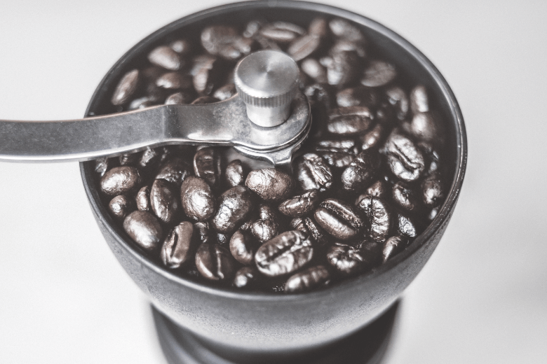 Manual coffee grinder with beans