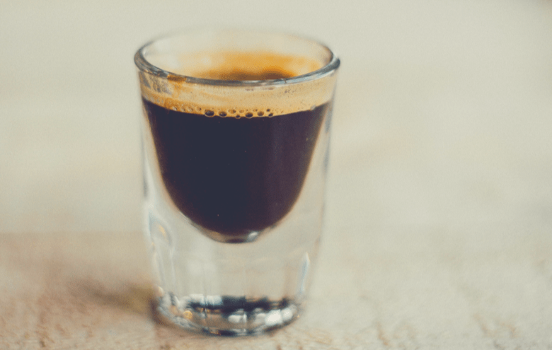 Photo of espresso shot with crema on top