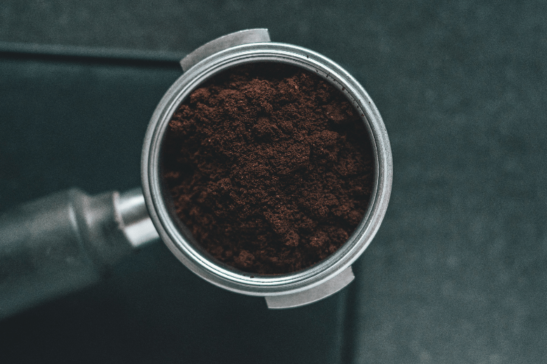 Portafilter filled with freshly ground coffee