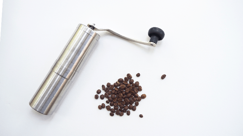 Hand grinder with coffee beans