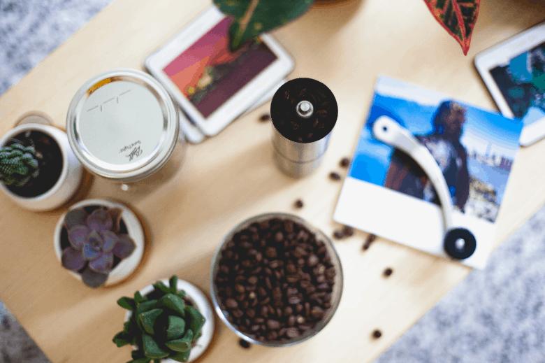 Manual coffee grinder full of coffee beans