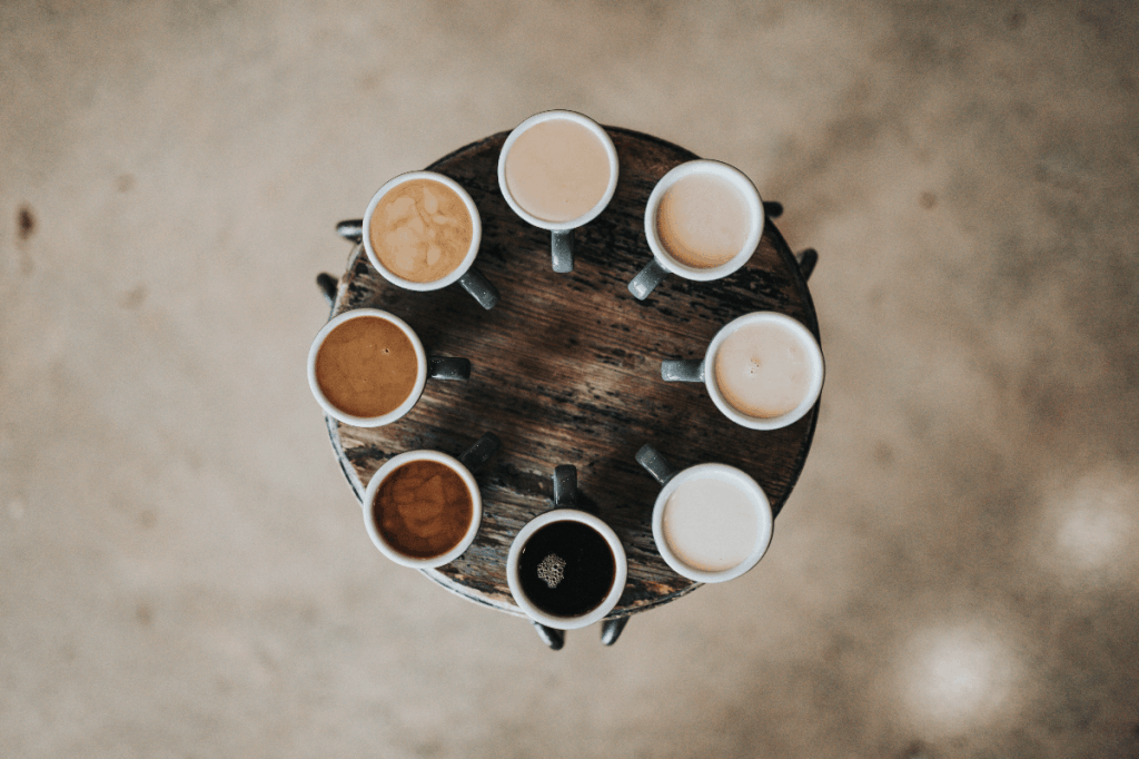 Photo of different types of coffees in cups