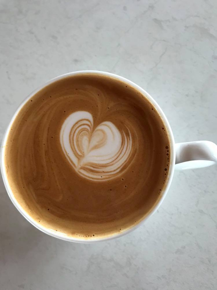 Coffee made with the Breville Dual Boiler showing latte art
