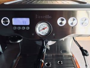 Image of front of Breville dual boiler showing buttons and espresso gauge and shot clock