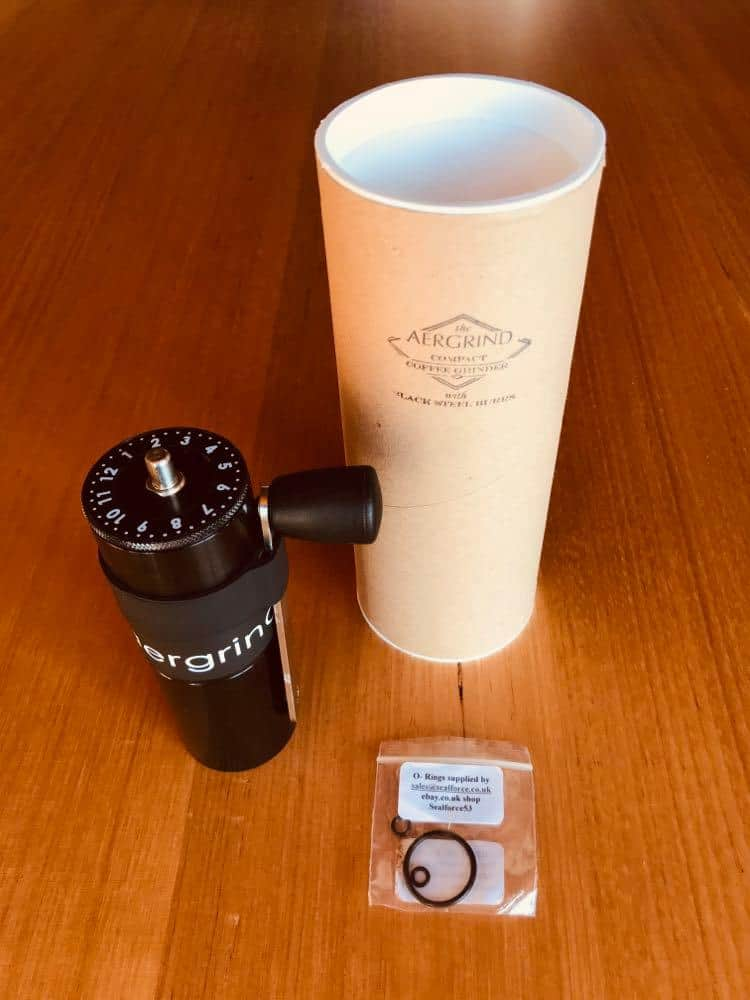 Aergrind with its original box, packed in a cylinder with spare O-rings