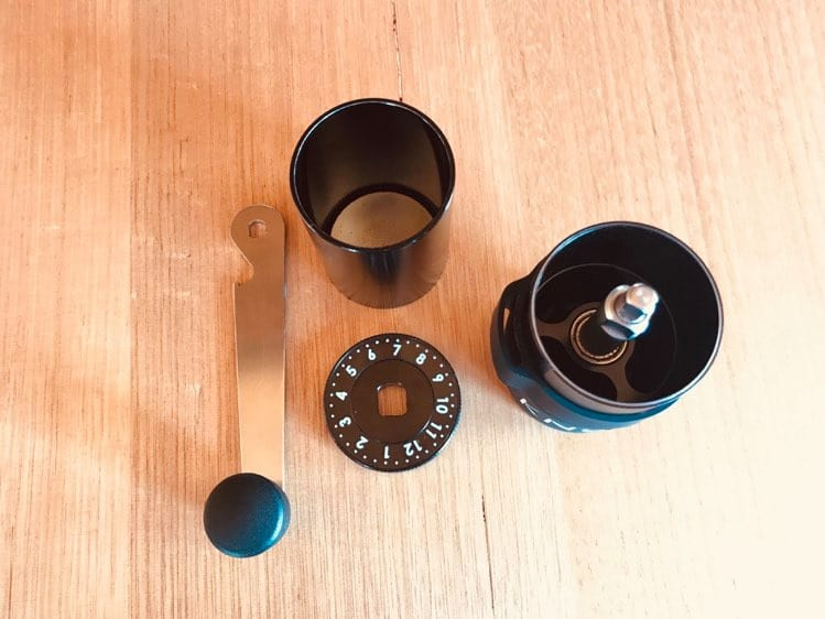 Photo of Aergrind hand grinder separated into parts