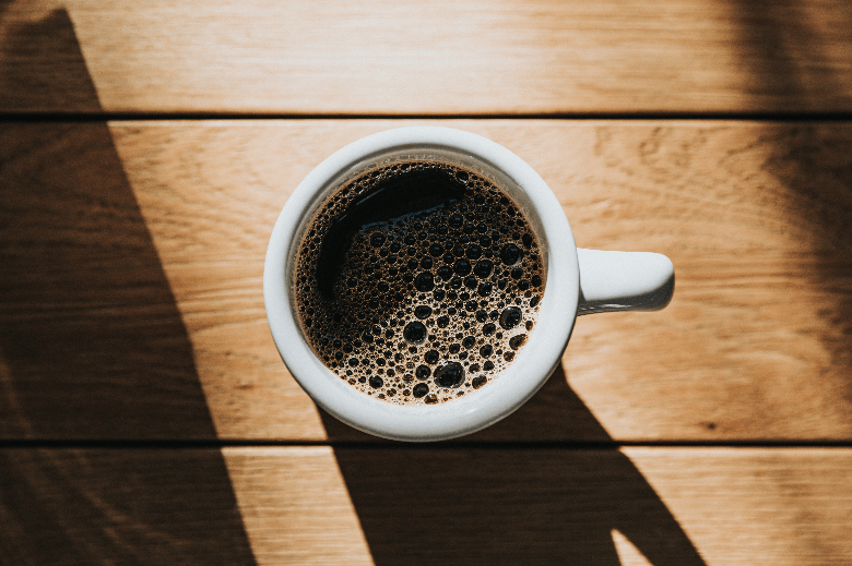 Photo of a cup of batch brew coffee