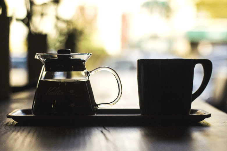 Photo of carafe of coffee and cup