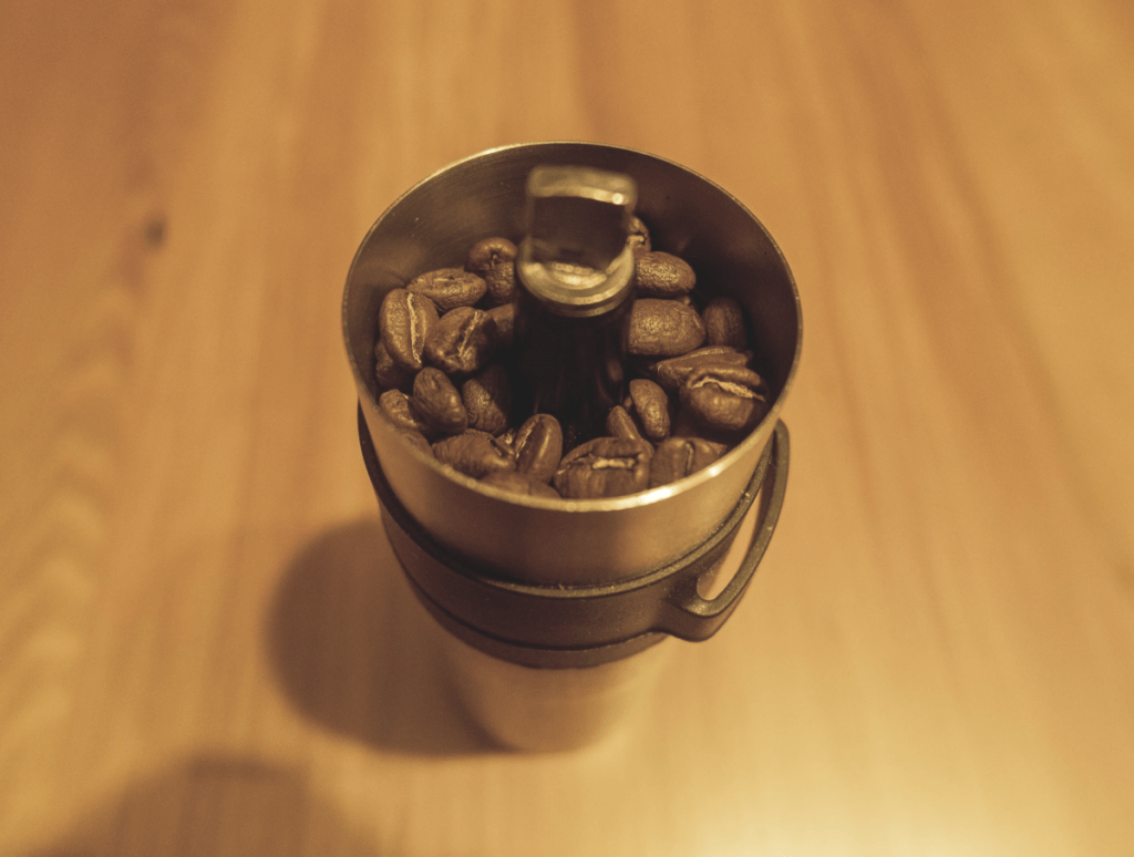 Porlex Mini hand grinder filled with coffee beans