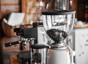 Image of Mazzer Mini grinder next to an espresso machine